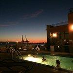 Rooftop pool/garden/hot tub area at night; looking toward Elliott Bay.