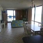 Kitchen towards living room and balcony