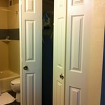 7/10/14 - Folding closet doors located inside bedroom opposite bathroom vanity.