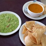 Chips and guac with a side of Frijoles .