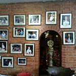 Nepalese restaurant on side with pictures of famous guests