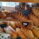 selection of freshly baked breads - Bavarian rye & wheat, Vienna Loaf, Corn Loaf
