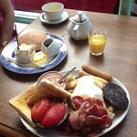 large cooked breakfast and maple syrup pancakes