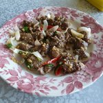 Ostrich meat with garlic, onions and red chilli
