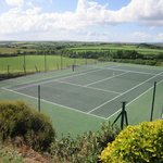 Tregaddra tennis court with sea views