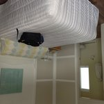 photo taken from doorway-room is: Motel, two people
