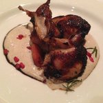 Quail with poached quince on a hazelnut espuma