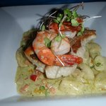 Cassava gnocchi with shrimps, conch and snapper