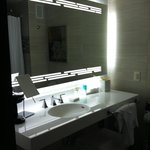Love the bright light and big mirror in the bathroom!