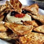 Hummus seved with pita bread.