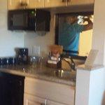 Microwave, coffee machine, fridge, and kitchen sink