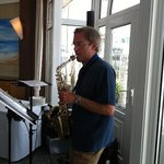Saxophonist entertaining the party guests