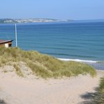 View from halfway down the sand dunes across the bay to St Ives