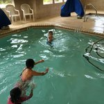 grandson and other kids having fun in the pool