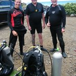 Charles, Kelly (middle and right) with our first dive instructor, Ben