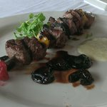 Appetizer special: filet kabob with cherry gastrique and blue cheese fondue