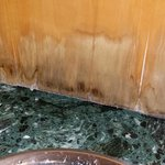 water damages veneer in bathroom
