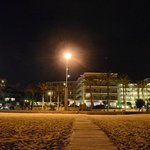 Hotel viewed from the beach in the night