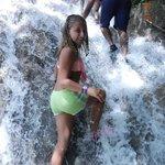 Madi climbing the falls