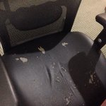 Ripped up chair in room