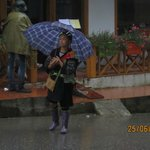 Black Hmong woman in the rain