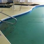 mats between pool and hot tub to prevent slipping:  didn't work