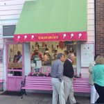 Customers line up in sweaters and jackets for ice cream.