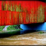 before the new coat of paint.  flooding at sandy creek covered bridge