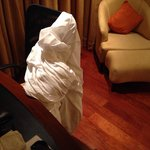 The bed sheet stacked away by the staff after the room was made  They forgot to take the sheet