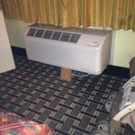 propped air conditioner unit