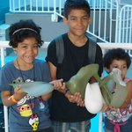 Our kids holding one of Winter's old prosthetic tails