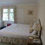Riverside bedroom with door onto balcony