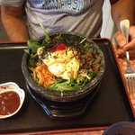 The Bibimbap served in a hot stone bowl