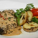 Peppersteak Madagascar with potatoes and seasonal vegetables
