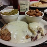 Hand-breaded chicken fried steak, mashed tater with skins