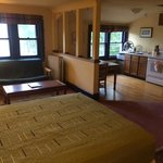 Sitting and kitchen area with windows that face lake