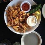 Calamari with lemon garlic aioli - and bits of lemon fried also - Delish
