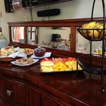 The breakfast buffet, yum, tropical fruits, toast, cheese, sausage