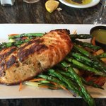Salmon over asparagus and other fresh vegetables