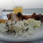 Rice, veggies, plantain, chicken and drinks by the sea? What a wonderful first evening!