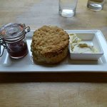 Perfect scone arrives with fresh jam and clotted cream
