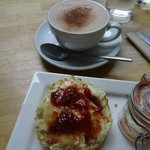 Perfect scone with fresh jam and clotted cream and an organic hot chocolate