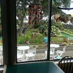 Dining area overlooking mini golf.