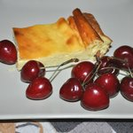 A typical Corsican Brocciu cheesecake, with fresh cherries.