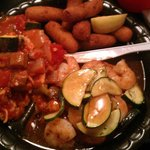 Grilled Salmon, Shrimp, Gumbo, Hushpuppies. (salmon is underneath shrimp and zucchini))
