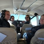 Satisfied passengers and a pretty cool pilot.