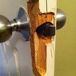 Closer shot of the door jamb that was kicked in, both baths! - we couldn't close bathroom door.