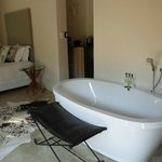Room with shower, bath and ample cupboards