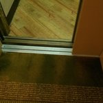 Worn carpet outside elevator made for a dicey step out