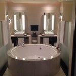 A bathroom to behold - a bath tub to swim in!